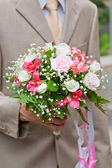Wedding bouquet in hand — Stock Photo