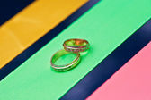 Wedding rings on a satiny — Stock Photo