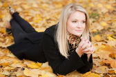 Autumn portrait of blonde girl — Stock Photo