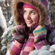 Photo: Beautiful young woman outdoor in winter