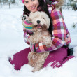 Happy woman with dog in winter forest — Stock Photo