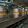 Stock Photo: Beer kegs on production line in factory