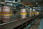 Beer kegs on the production line in the factory — Stock Photo