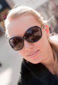 Young woman wearing the big modern sunglasses. — Stock Photo