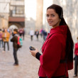 Young woman with headphones, listening to audio guide - Stok fotoğraf