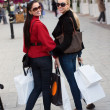 Happy smiling women shopping with white bags — Stock Photo #4367404