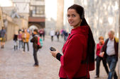 Young woman with headphones, listening to audio guide — Stock Photo