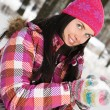 Beautiful young woman outdoor in winter playing with snow — 图库照片