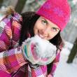 Beautiful young woman outdoor in winter playing with snow — Stock Photo #4697920