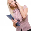 Beautiful business woman with telephone and folder isolated on w — Stock Photo