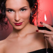 Beautiful young woman with glass of red wine — Stock Photo