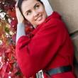 Young women in red coat on the street — Stock Photo #4791939