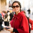 Young woman with headphones, listening to audio guide - 图库照片