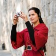Young woman with headphones, listening to audio guide taking pic — Stock Photo #4791950