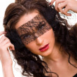 Portrait of young beautiful brunette woman with lace on her eyes — Stock Photo #4911153