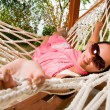 Young woman in hammock - 