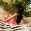 Young woman in hammock — ストック写真