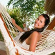 Young woman in hammock — Stock fotografie