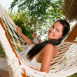 Royalty-Free Stock Photo: Young woman in hammock
