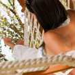 Young woman in hammock — Stock Photo