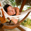 Young woman in hammock — Stok fotoğraf