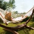 Young woman in hammock — Stockfoto