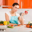 Beautiful young woman cooking in the kitchen — Stock Photo #5235459