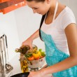 Beautiful young woman cooking in the kitchen — Stock Photo #5235558