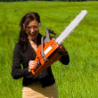 Stock Photo: Womwith chainsaw