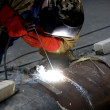 Welder welding with acetylene arc - Stock Photo