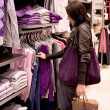 The woman buys clothes in shop — Stock Photo #4853160