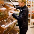 The woman buys nuts (Focus on hands) — Stock Photo #4853173