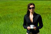 The woman drinks coffee — Stock Photo