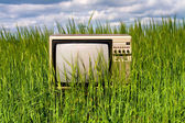 The TV in the field — Stock Photo