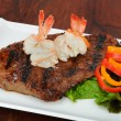 Rib-eye steak with boiled shrimp on top. — Stock Photo