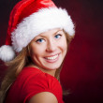 Young christmas woman over dark — Stock Photo
