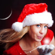 Young christmas woman holding star over dark — Stock Photo #3963778