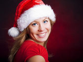 Young christmas woman over dark — Stock Photo