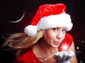 Young christmas woman holding star over dark — Stock Photo