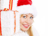 Young christmas woman with presents — Stock Photo