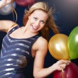 Smiling woman on party holding ballons — Stock Photo #4006723