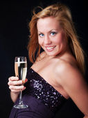 Smiling young woman with sylvester champagne — Stock Photo
