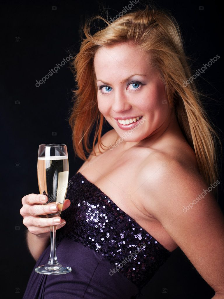 Smiling young woman with sylvester champagne over dark background — Stock Photo #4006724