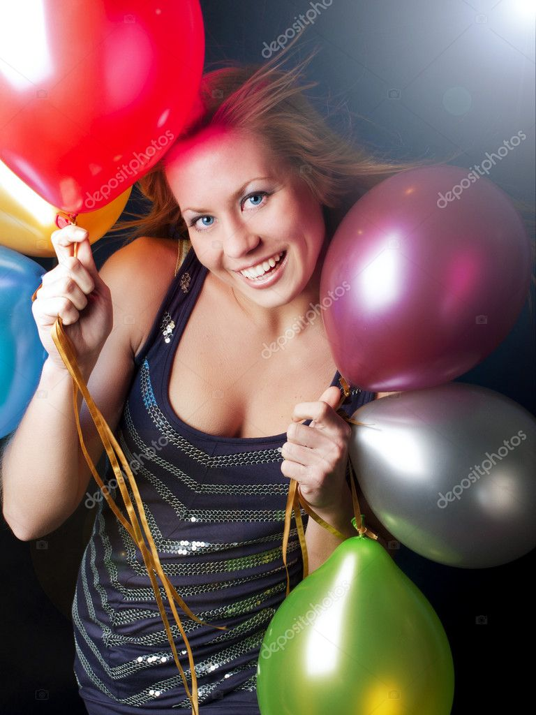 Smiling young woman on party holding balloons — Photo #4006780