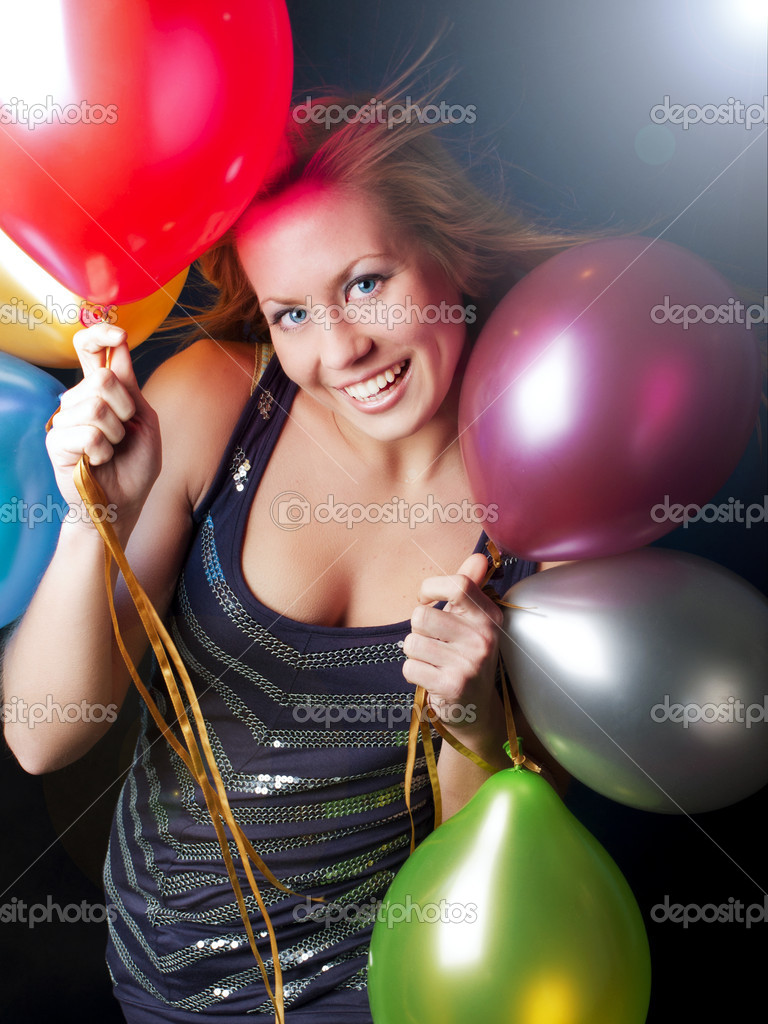 Smiling young woman on party holding balloons — Stock Photo #4006780