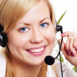 Closeup of smiling blond woman with headphone in office — Stock Photo #4062087