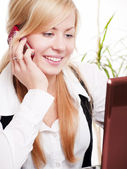 Woman in office calling by phone — Stock Photo
