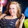 Woman on party holding ballons — Stock Photo