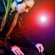 Dj woman playing music by mixer — Stock Photo