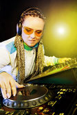 Dj woman playing music by mixer — Stock Photo